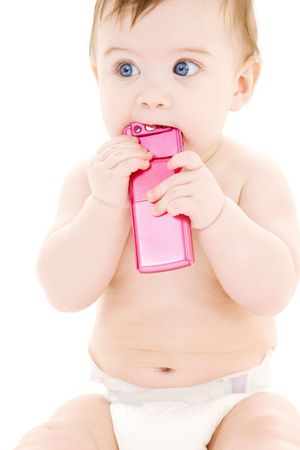 picture of baby boy in diaper with pink cell phone Stock Photo - 3199884