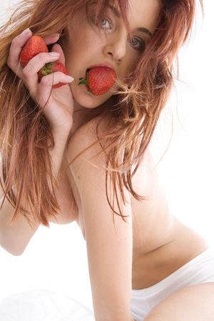 lovely girl with strawberry over white (focus on strawberry) Stock Photo - 3199918