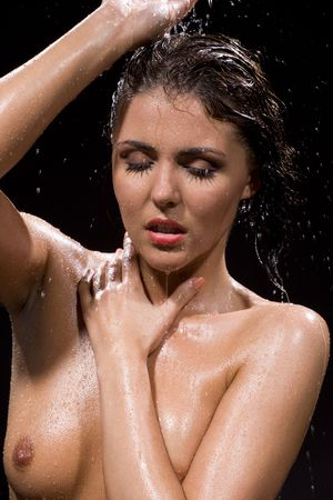 aqua naked: picture of wet brunette girl over black