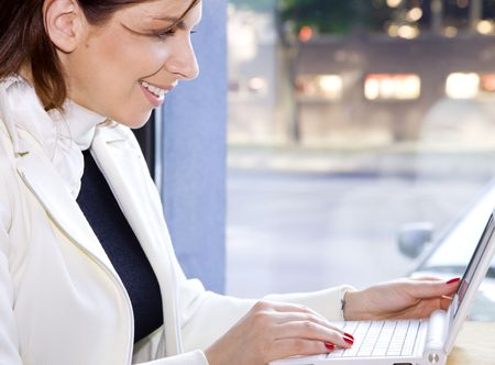 bright picture of happy businesswoman surfing internet Stock Photo - 3199975