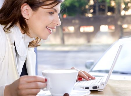 happy businesswoman drinking morning coffee and surfing internet Stock Photo - 3199977