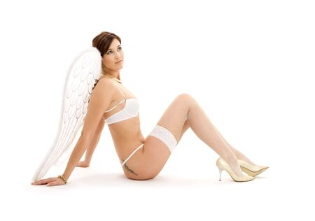 lace up: picture of brunette angel girl in white lingerie