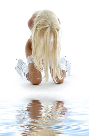 tanned blond in  boots and fishnet stockings on white sand Stock Photo - 3307653