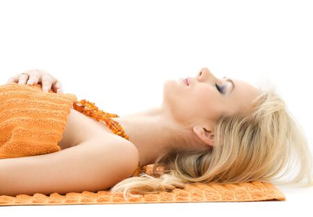 with orange and white body: beautiful lady with orange towels in spa salon