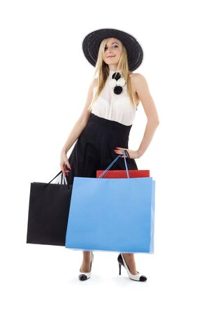 careless: elegant blonde in retro hat with shopping bags