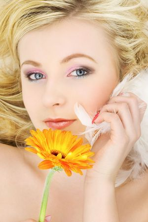 rejuvenating: picture of blonde girl with flower and feathers