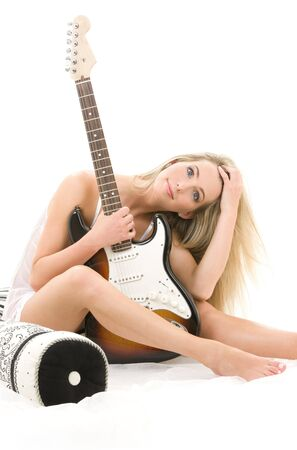 lovely blonde with electric guitar over white Stock Photo - 3348514