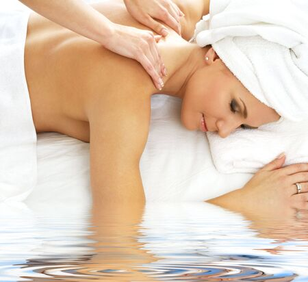 heal care: picture of lovely lady relaxing in massage salon
