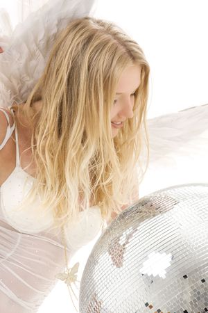 sexy angel: lingerie angel girl with disco ball over white LANG_EVOIMAGES
