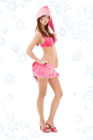 santa helper girl in pink lingerie with snowflakes Stock Photo