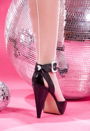 leg in high heels shoe and disco balls over pink Stock Photo - 3348633