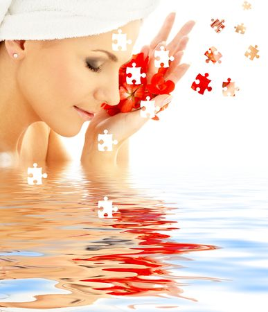 puzzle of lovely woman with red flower petals in water