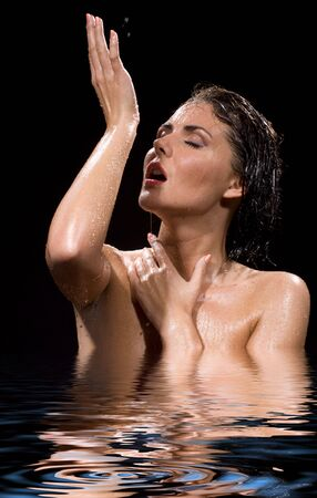 aqua naked: picture of wet brunette girl in water