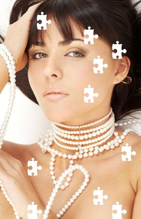 carnal: puzzle portrait of mysterious brunette with white pearls