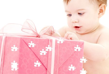 puzzle picture of baby boy with big gift box Stock Photo - 3465120