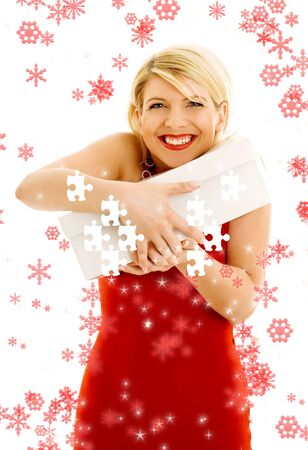 thankful girl holding puzzle box surrounded by snowflakes photo