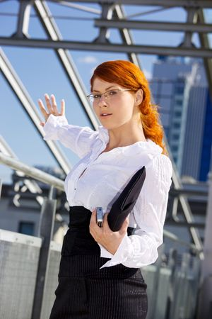 happy businesswoman standing in a front of a building site Stock Photo - 3465158