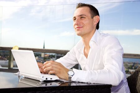 picture of handsome businessman on leisure with laptop Stock Photo - 3465174