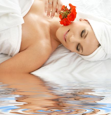 lovely woman in spa smelling red flower Stock Photo - 3465203