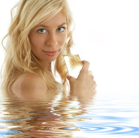 pretty blonde with glass of champagne in water Stock Photo - 3465204