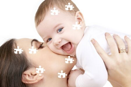 puzzle picture of happy mother with baby over white Stock Photo - 3465197