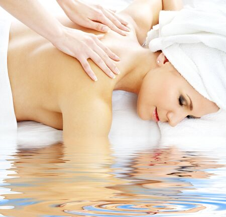 healing touch: picture of lovely lady relaxing in massage salon