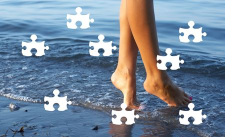 rejuvenating: puzzle picture of female legs in blue water
