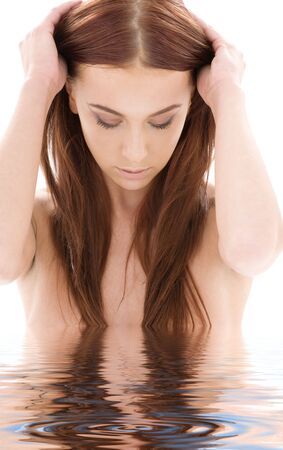 aqua naked: picture of lovely long hair girl in water