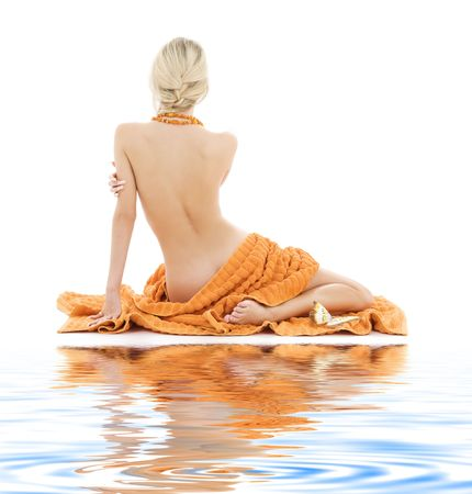 aqua naked: beautiful lady with orange towels on white sand