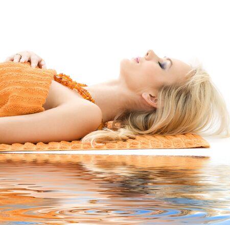 with orange and white body: bella dama naranja con toallas en sal�n spa