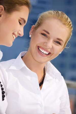 picture of two happy businesswomen (focus on blonde) Stock Photo - 3465287