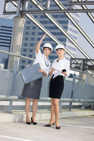 young female contractors in a front of building site Stock Photo - 3465293