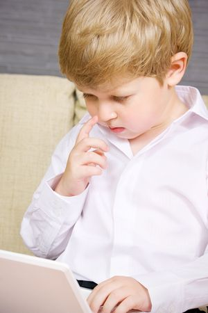 picture of  boy with white laptop computer Stock Photo - 3465295