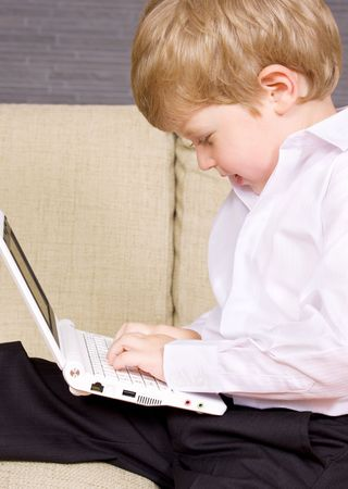 picture of happy boy with white laptop computer Stock Photo - 3465301