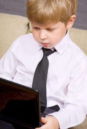picture of  boy with black laptop computer Stock Photo - 3465298