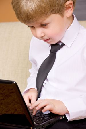picture of happy boy with black laptop computer Stock Photo - 3465296