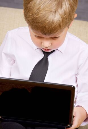 picture of  boy with black laptop computer Stock Photo - 3622916