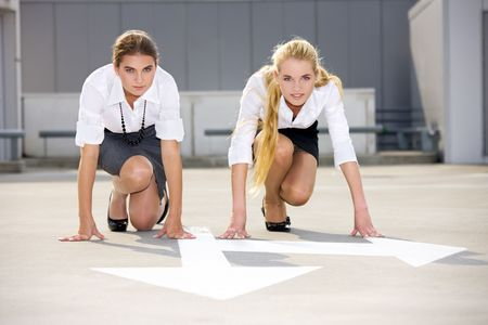 arrow pointer and two confident businesswomen ready for race Stock Photo - 3465315
