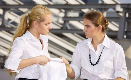 picture of two angry businesswomen fighting for contract Stock Photo - 3465321