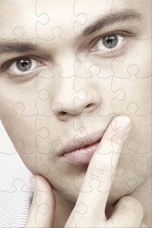 puzzle portrait of handsome man with blue eyes photo