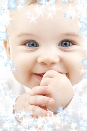 bright closeup portrait of adorable baby with snowflakes