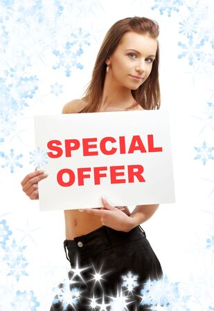 lovely girl holding special offer word board with snowflakes Stock Photo - 3474816
