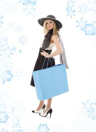 elegant blond in retro hat with blue shopping bag Stock Photo - 3474813