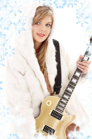 golden guitar girl in fur with snowflakes Stock Photo - 3491692