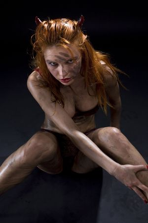 dirty devil girl in red lingerie over black Stock Photo - 3540572