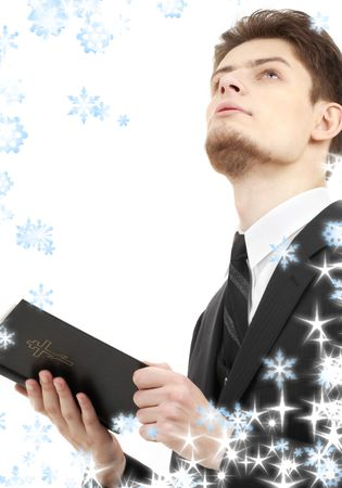 picture of man with holy bible and snowflakes photo
