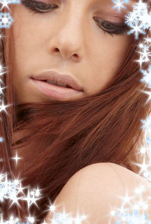 carnal: closeup portrait of sensual redhead with long hair and snowflakes Stock Photo