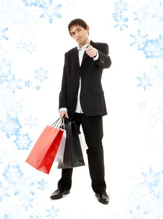 handsome man with shopping bags and snowflakes Stock Photo - 3558102