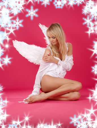 angel alone: picture of lonely christmas angel girl over pink