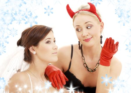 picture of angel and devil girls with snowflakes Stock Photo - 3641489